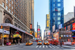 Times Square ,is a busy tourist intersection of neon art and com Stock Photo