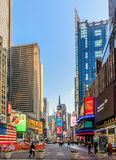 Times Square ,is a busy tourist intersection of neon art and com Stock Images