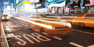 Times square cabs coming to a stop Stock Photo