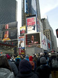 Times Square Crowd Watches. Big crowds observe history in Times Square, NY as Barack Obama is inaugurated as the 44th President of the United States stock photography
