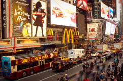 Times Square crowds and traffic at evening. Royalty Free Stock Image