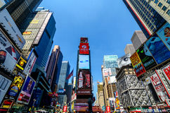 Times Square Daytime scene. Scene featuring the numerous neon signs, billboards, skyscrapers and other commercial attractions of the Times Square section of Royalty Free Stock Photography