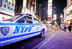 Times Square at evening with NYPD car. In foreground, January 7, 2011 in Manhattan, New York City royalty free stock image