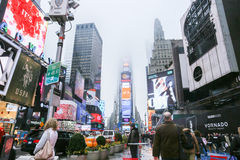 Times Square in the fog, New York City. Times Square in the fog in New York City Stock Photos