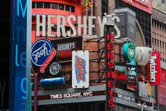 Times Square Hersheys. NEW YORK, USA - JULY 3, 2013: Famous Hershey's ad at Times Square in New York. Hershey Company is a chocolate manufacturer founded in 1894 royalty free stock photo