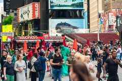 Crowded Time Square, New York City. Skyscrapers, Billboards, Neon Art, Street Artists, and Tourists royalty free stock images