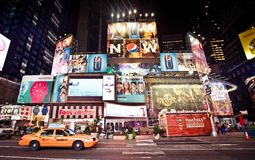 Times Square is an iconicplace of New York City an. NEW YORK CITY - JULY 20: Times Square, is a busy tourist intersection of neon art and commerce and is an royalty free stock images