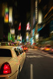 Times Square Limo New York USA. White limo driving South down Broadway from 48th Street, New York City stock photo