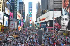 The worlds famous Times Square in New York City day time Stock Images