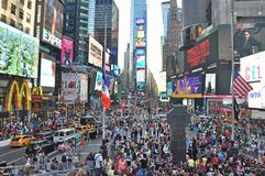The worlds famous Times Square in New York City day time Stock Photos