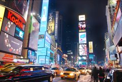 Times Square, Manhattan, New York City. With busy traffic and yellow cab stock photos