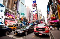 Times Square at morning. Times Square, FDNY car on animated LED signs background, is a symbol of New York City and the United States, January 6, 2011 in stock images