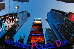 Times square neon signs at dusk. New york police dept sign times square Royalty Free Stock Image