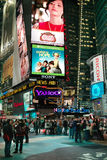 Times Square New York USA. Times Square New York. NYPD Station is dwarfed by giant advertising signs above stock photo