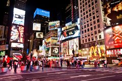 Times Square, New York. Times Square featured with Broadway Theaters and animated LED signs is a symbol of New York City and the United States. Moving people and royalty free stock image
