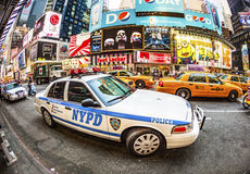 Times square in New York in afternoon light with police car Stock Photography