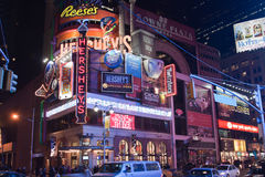 Times Square New York City. The neon lights on the shops at the busy Times Square. Manhattan Island, New York City, USA royalty free stock image