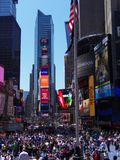 Times Square in New York City. The lights are on even in the height of noon in the city that never sleeps Stock Photos