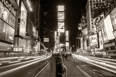 Times Square in New York City. The famous Times Square in New York city, USA at night in a sepia toned vintage-like shot stock photos