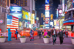 Times Square New York. New York City -April 8: Times Square, featured with Broadway Theaters and animated LED signs, is a symbol of New York City and the United Royalty Free Stock Photos