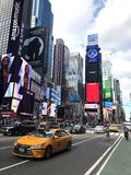 Times Square in New York City. Times Square as The Crossroads of the World it`s the brightly illuminated hub of the Broadway Theater District. Times Square is royalty free stock image