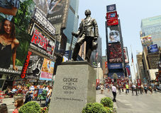 TIMES SQUARE, NEW YORK CITY  BROADWAY. NEW YORK CITY : Times Square, George M. Cohan statue  busy tourist attraction of neon signs and commerce and is an iconic Royalty Free Stock Photo