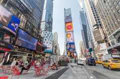 Times Square. NEW YORK CITY - JULY 22: People visit Times Square on July 22, 2014 in New York. Times Square is a major commercial intersection in Manhattan, at stock photos