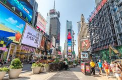 Times Square. NEW YORK CITY - JULY 22: Undefined people pass through Times Square on July 22, 2014 in New York. Times Square is a major commercial intersection stock photos