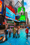 Times Square, New york. NEW YORK CITY -MARCH 25: Times Square, featured with Broadway Theaters and animated LED signs, is a symbol of New York City and the royalty free stock photo