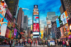 Times square in New York City. NEW YORK CITY - MAY 11: Times Square with tourists on May 11, 2013. Iconified as The Crossroads of the World it's the brightly