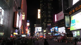 Times Square New York City at night. New York, USA - December 1, 2015: Crowds of locals and tourists gather on new York City's Times Square at night stock video