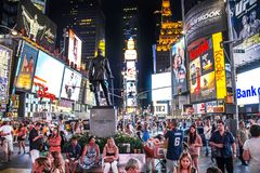 Times Square, New York City, New York, United States - circa 2012 large crowds of people tourists at George M Cohan statue. Large crowds of people tourists at Stock Photo