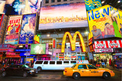Times Square, New York City. USA. NEW YORK CITY -MARCH 25: Times Square, featured with Broadway Theaters and animated LED signs, is a symbol of New York City royalty free stock images