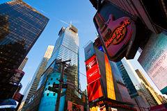 Times Square, New York City. USA. NEW YORK CITY -MARCH 31: Site of the former the Paramount theater, this landmark Hard Rock Cafe sits in the heart of Times Stock Image