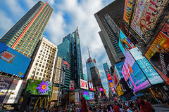 Times Square New York City. Wide angle view of Times Square in New York City. Colors abound from the neon lights and advertising signs. The location is a popular stock image