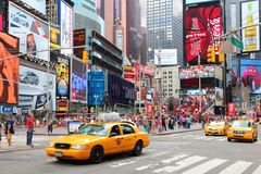 Times Square. NEW YORK - JULY 4: People visit Times Square on July 4, 2013 in New York. Times Square is one of most recognized landmarks in the world. More than stock image