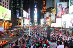 Times Square, New York. NEW YORK - JULY 1: People visit Times Square on June 1, 2013 in New York. Times Square is one of most recognized landmarks in the world stock photography