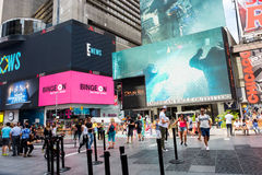 Times Square. New York, NY: August 28, 2016: New York Times Square large LED signs/billboards. On an average day, 360,000 people visit Times Square Royalty Free Stock Photo