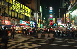 Times Square New York USA Panorama. Times Square at night, with a crowd around The Naked Cowboy stock photography