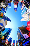 Times Square. NEW YORK - SEPT 22: Times Square is a busy tourist intersection of neon art and commerce and is an iconic street of New York City and America royalty free stock photos