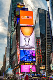 Times Square New York. New York - Sept 2014: The glamorous streets of Times Square New York with thousands of tourists and residents are lit with giant screens stock images