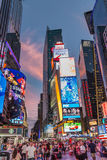 Times Square New York. New York - Sept 2014: The glamorous streets of Times Square New York with thousands of tourists and residents are lit with giant screens royalty free stock photo
