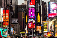 Times Square New York. New York - Sept 2014: The glamorous streets of Times Square New York with thousands of tourists and residents are lit with giant screens Royalty Free Stock Image
