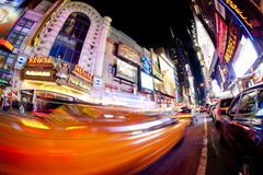 Times Square. NEW YORK - SEPT 22: Times Square and 42nd Street is a busy tourist intersection of neon art and commerce and is an iconic street of New York City Stock Photos