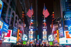 Times Square, New York, USA. NEW YORK CITY -MARCH 25: Times Square, featured with Broadway Theaters and animated LED signs, is a symbol of New York City and the royalty free stock image