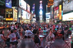 Times Square New York. NEW YORK, USA - JULY 1, 2013: People visit Times Square in New York. The square at junction of Broadway and 7th Avenue has some 39 million stock images