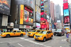 Times Square. NEW YORK, USA - JULY 3, 2013: Taxis drive along Times Square in New York. Times Square is one of most recognized landmarks in the USA. More than royalty free stock photography