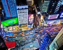 Times Square. NEW YORK, USA - JUNE 29th, 2014: Aerial view of Times Square the popular New Year's Eve destination with crowds and taxi cabs in motion in New York royalty free stock photography