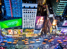Times Square. NEW YORK, USA - JUNE 29th, 2014: Aerial view of Times Square the popular New Year's Eve destination with crowds and taxi cabs in motion in New York Stock Photos