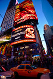 Times square new York. New York, USA - November 17, 2015: View of on Times square new York with traffic rushing passed and taxis in the autumn and people walking stock images